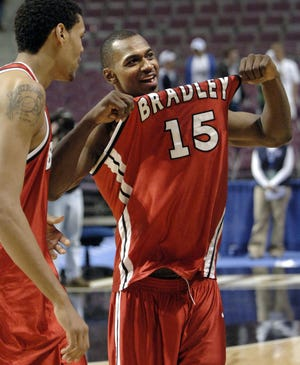 Marcellus Sommerville shows off his jersey after the Bradley men's basketball team upset Kansas in the 2006 NCAA Tournament.