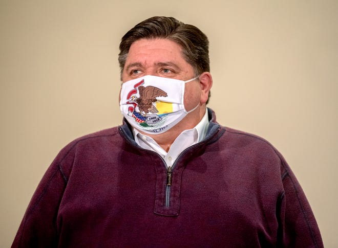 Gov. JB Pritzker stands by as five OSF HealthCare St. Francis Medical Center employees are immunized with the Pfizer COVID-19 vaccine Tuesday, Dec. 15, 2020 at Jump Trading Simulation and Education Center in Peoria.
