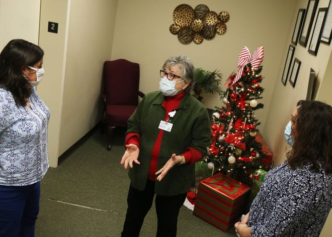 Kinston Community Health Center CEO Lisa Wallace, center, talks about the possibility of the center receiving COVID-19 vaccines either in January or February with director of health informatics and information management Tracie Zeagler, left, and COO Suzanne Freeman on Tuesday, Dec. 15, at the center.