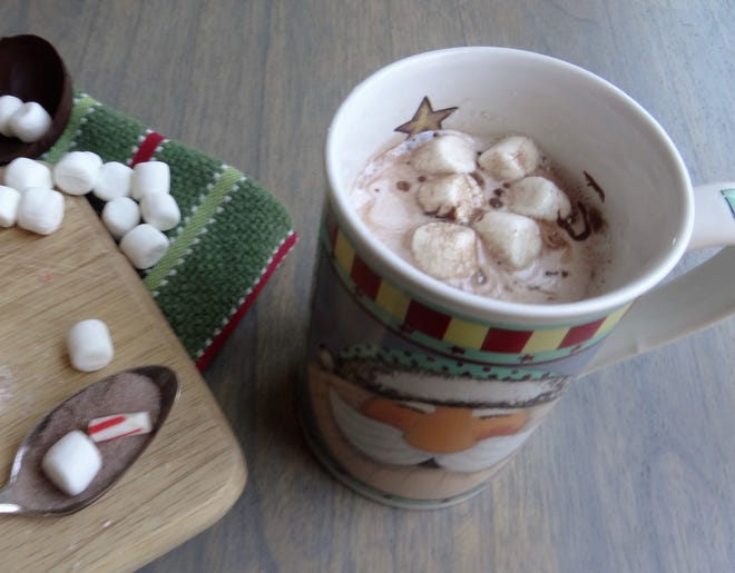 Watching a cocoa bomb melt in a hot cup of milk and then topping it off with marshmallows is the perfect holiday treat for any hot cocoa lover.