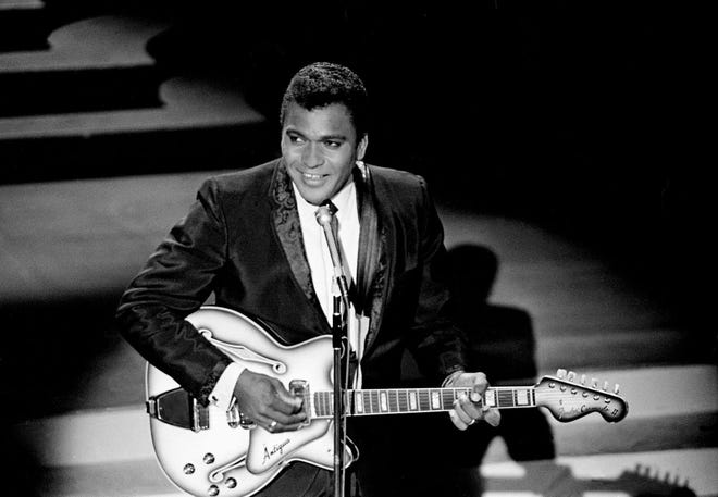 Charley Pride performs one of the five songs nominated for Single of the Year during the third annual CMA Awards show at the Ryman Auditorium on Oct. 15, 1969.