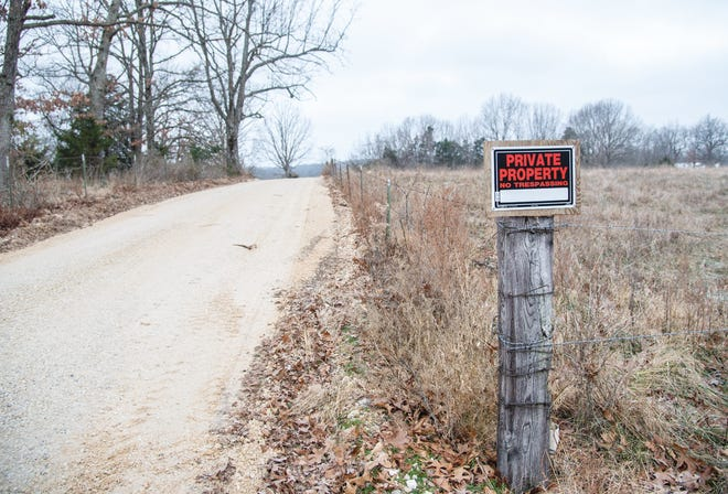 A private property sign can be seen posted on the gravel roadway near Crater Hill Road that was said to have had county road work done recently.
