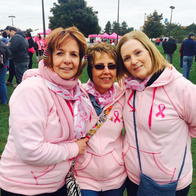 From left: Best friends Cathie Donner, Lynda Lochner and Sue Simpatico, are seen in October 2014 at an event for breast cancer awareness. Simpatico had received an early diagnosis of breast cancer and lymphoma the month before and later went on to undergo stem cell replacement, chemotherapy and a mastectomy. Recovered from cancer, Simpatico and her experience inspired Donner to donate the charity portion of her Paint it all Pink winnings to Elizabeth Wende Breast Care.