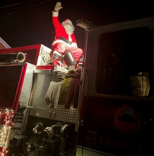 Santa Claus made a special appearance in Millbury Saturday, Dec. 12,2020, on board a big, red fire engine decked out for the holidays, riding through the streets of Millbury.