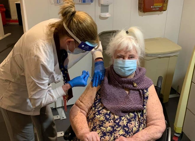 """World War II veteran Margaret Klessens, 96, was vaccinated for COVID-19 at 12:07 p.m. Monday at the Edith Nourse Rogers Memorial Veterans Hospital at the VA in Bedford. Klessens was """"the first VA patient nationwide"""" to receive the vaccine, according to the VA."""