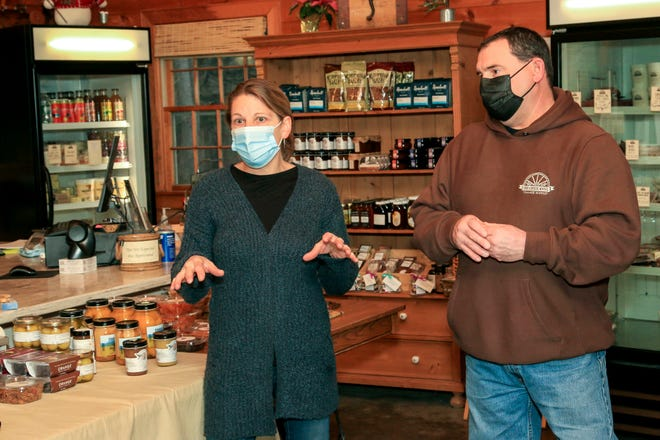 Diana and Bill Bothelo talk about the expansion to their shop, The Cheese Wheel, in Tiverton.