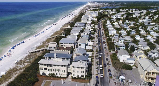 Scenic Highway 30A stretches along the Gulf of Mexico shoreline though towns like Seaside, where traffic congestion can be a problem.