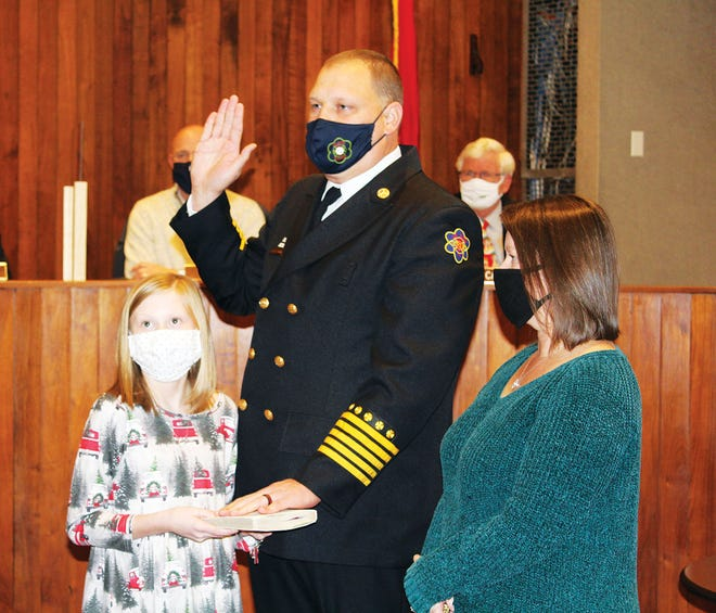 Travis Solomon is sworn in as the city of Oak Ridge's new fire chief during Monday night's City Council meeting in the Municipal Building Courtroom He is joined by his daughter, Brooke, and his wife, Nicole.