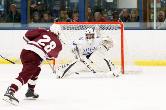 Goaltender Cam Manley (30) was one of many Whitesboro boys hockey players that helped the Warriors qualify for the state tournament before COVID-19 canceled the tournament in March.