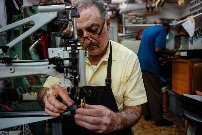 Third-generation shoemaker, Victor Mnatsakanian, who is the owner of Sparkles Shoes and Shoe Repair on Sunrise Avenue, uses a patch leather sewing machine to repair a belt