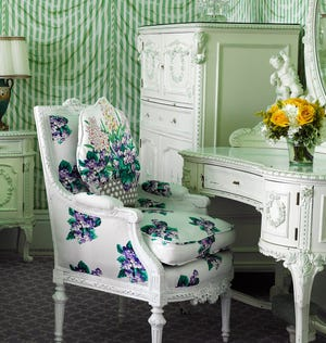 A vase of flowers stands on a vanity in the Josephine Suite at Grand Hotel on Michigan's Mackinac Island.