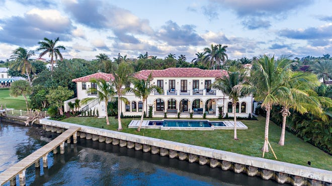 On an irregularly shaped lot, a house developed on speculation at 235 Via Vizcaya in the Estate Section faces 155 feet of frontage on the Intracoastal Waterway.