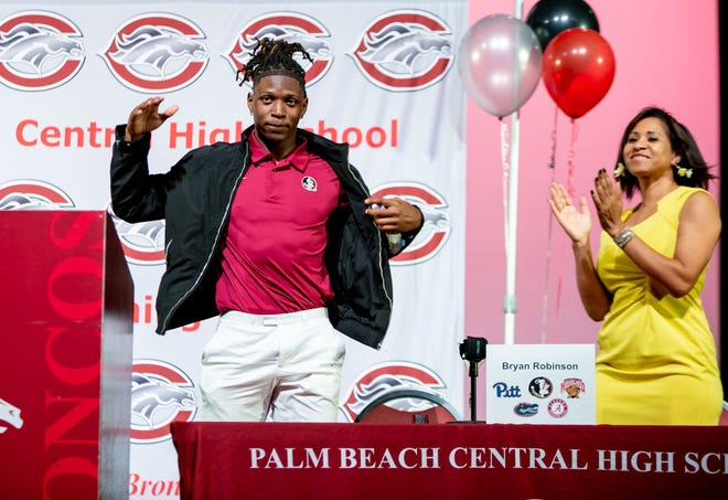 This scene from a year ago, when Palm Beach Central receiver Bryan Robinson announced he was signing with Florida State during a ceremony at the school, will not be repeated this year because of COVID-19.