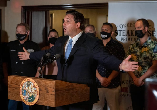 Gov. Ron DeSantis speaks during a press conference at the Okeechobee Steakhouse on Dec. 15 in West Palm Beach. DeSantis talked about the importance of keeping restaurants open during the pandemic to help employees earn a living.