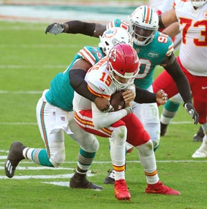 Dolphins linebacker Jerome Baker sacks Chiefs quarterback Patrick Mahomes during Sunday's game at Hard Rock Stadium.