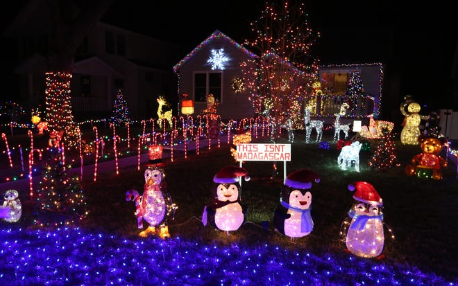 Christmas lights shine brightly in the front yard of a home in the 100 block of West 19th Ave in Hutchinson Wednesday evening, Dec. 9, 2020.