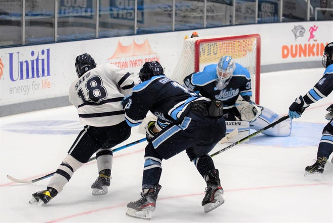 University of New Hampshire senior forward Kohei Sato puts a shot on net during last Friday's Hockey East men's hockey game against Maine at the Whittemore Center in Durham.