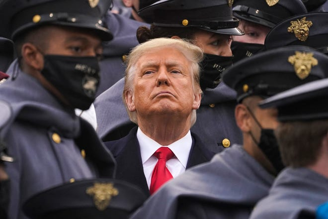 President Donald Trump, surrounded by Army cadets, watches the first half of the Army-Navy Football Game in West Point, New York, on Dec. 12.