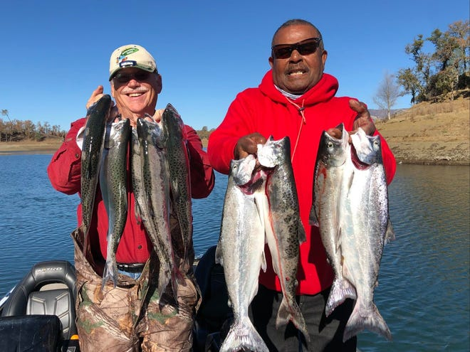 Warren Trumbly and Dave Clark show off the landlocked king salmon that they landed while mooching with Alan Fong at Lake Berryessa on Dec. 10.