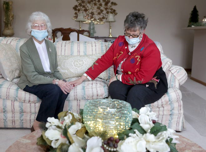 """Sue Ambrosic, right, blushes as her neighbor, June Kanney calls her """"her angel on Earth."""" Kanney nominated Ambrosic to be one of The Canton Repository's Unsung Heroes for 2020. The Massillon Independent and Repository are both owned by Gannett."""