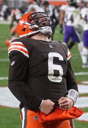 Browns quarterback Baker Mayfield (6) celebrates after running for a touchdown late in the second half of a game against the Baltimore Ravens, Monday, Dec. 14, 2020, in Cleveland, Ohio. [Jeff Lange/Beacon Journal]