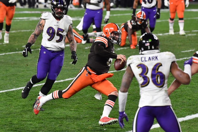 Browns quarterback Baker Mayfield runs for a touchdown as Baltimore Ravens defensive end Derek Wolfe (95) and strong safety Chuck Clark (36) defend during the second half, Monday, Dec 14, 2020, in Cleveland. (Ken Blaze-USA TODAY Sports)