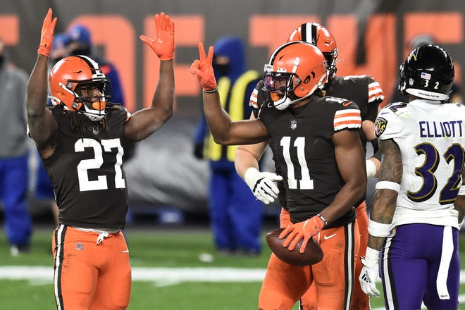 Browns running back Kareem Hunt (27) and wide receiver Donovan Peoples-Jones (11) celebrate after Peoples-Jones caught a 2-point conversion during the second half against the Baltimore Ravens, Monday, Dec 14, 2020, in Cleveland. (Ken Blaze-USA TODAY Sports)