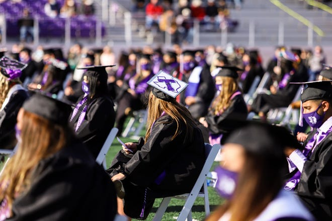 A Tarleton graduates shows her school spirit by displaying the university logo on her mortar board during last weekend's commencement ceremonies at Memorial Field.