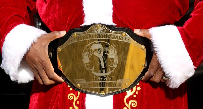 Titus Hopper wears a special belt made to showcase Hop the Black Santa.