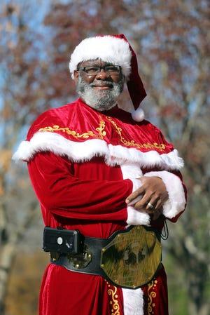 Titus Hopper dresses as Hop the Black Santa to bring joy to local children.