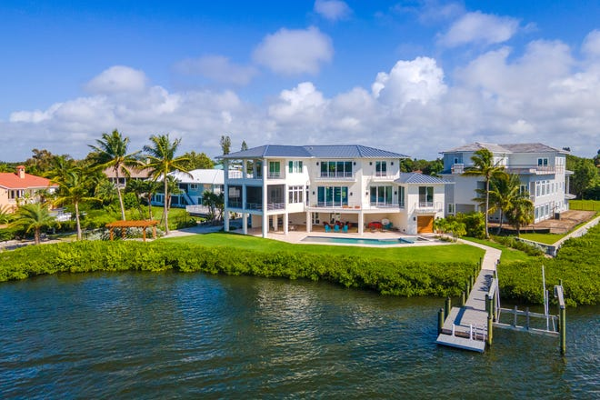 The Brian Phipps designed elevated two-story, four bedroom, four bath (and three half baths) home of 5,110-square feet. Every room has a water view and scenic views of the 300-feet of shoreline on Little Sarasota Bay.