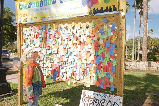 Venice resident Sally Flanagan stopped by the Positivity Wall at Centennial Park in Venice on Dec. 10, to see what had been placed there recently. The communal message board was one of five in south Sarasota County that were taken down Tuesday.