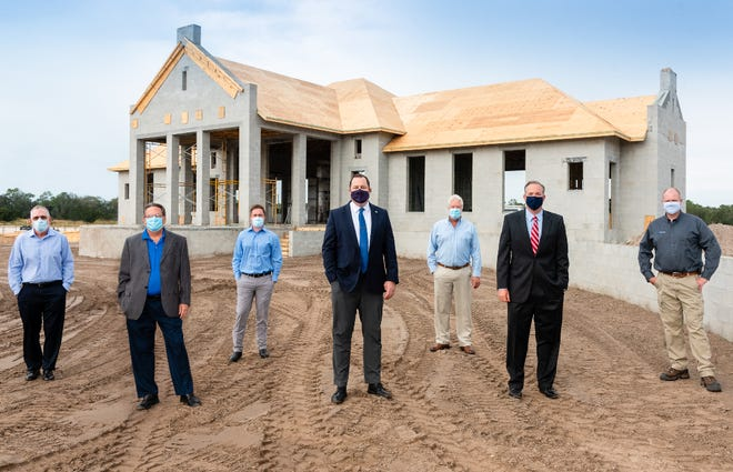 Randy Olson, left, John Leinaweaver, Fabio Hediger, Mark Evans, Thom Boyer, Chris Clark and Sean Finotti, at the site where the amenity complex is being constructed for Windward at Lakewood Ranch.
