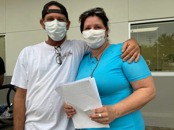 Jennifer and Charles McDonald of Manatee County were among the 23 clients lined up outside of Turning Points waiting to apply for rent and utility assistance Monday morning. The McDonalds came to Turning Points to seek assistance for their past-due water bills that have totaled up to $422.