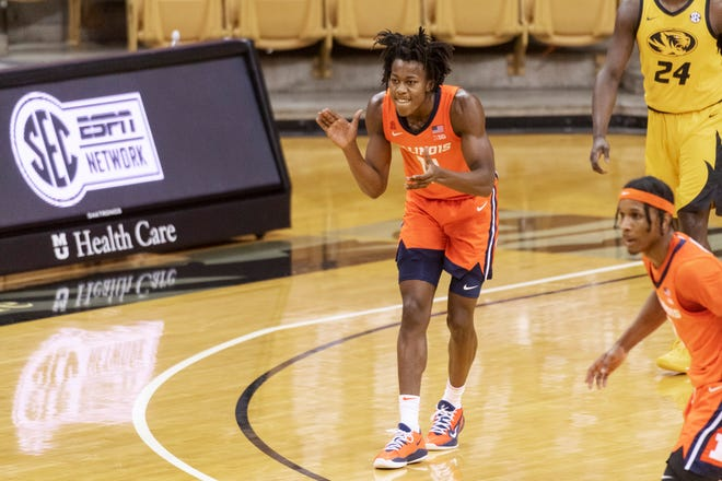 Illinois' Ayo Dosunmu claps as he plays Missouri during the first half Satuday in Columbia, Mo. [L.G. PATTERSON/THE ASSOCIATED PRESS]