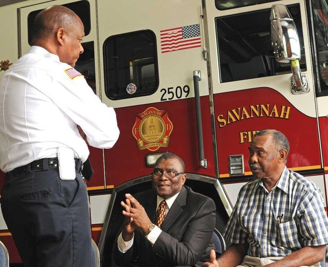 Former Savannah Fire & Emergency Services Chief Charles Middleton, standing, speaks with Purdy Bowers, center, and Lewis Oliver in 2013. On May 1, 1963, Bowers and Lewis were among six black men hired by the Savannah Fire Department as it re-integrated. [File photo/SavannahNow.com]