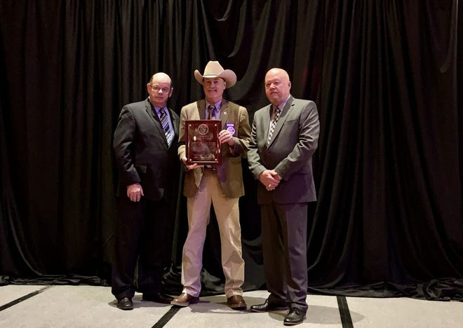 Sheriff Michael D. Booth was inducted into the Oklahoma Sheriffs' Association Hall of Fame.
