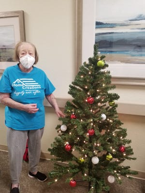 Residents at the Regency in Shawnee decorate their Christmas trees.