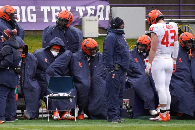 Illinois players react as they sit on the bench during the second half of an NCAA college football game against Northwestern in Evanston, Ill., Saturday, Dec. 12, 2020. Northwestern won 28-10.