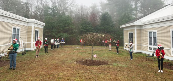 The Middleborough High School Marching Band visited the Nemasket Health Care Center and the Hannah B. Shaw Home on Saturday to play some Holiday classics for residents and staff.