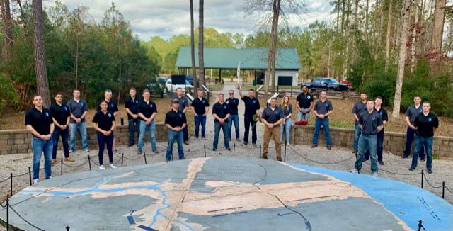 Pictured are the unit members OF Marine Wing Communications Squadron-28 at the Gateway Plaza map at Battlefield Park in New Bern. [CONTRIBUTED PHOTO]
