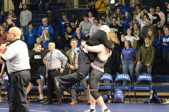Washburn Rural's David Huckstep (left) gives coach Damon Parker a hug after a dual-clinching win last season. Huckstep has delivered twice in that secnario this season, helping Rural to a 6-0 dual record with five wins against ranked teams