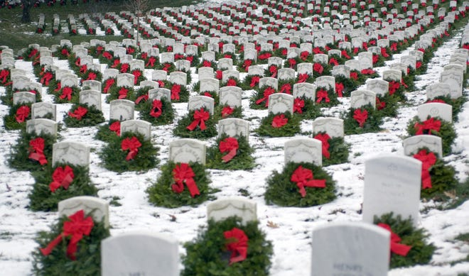 Christmas wreaths adorn headstones at Arlington National Cemetery in Virginia on National Wreaths Across America Day.