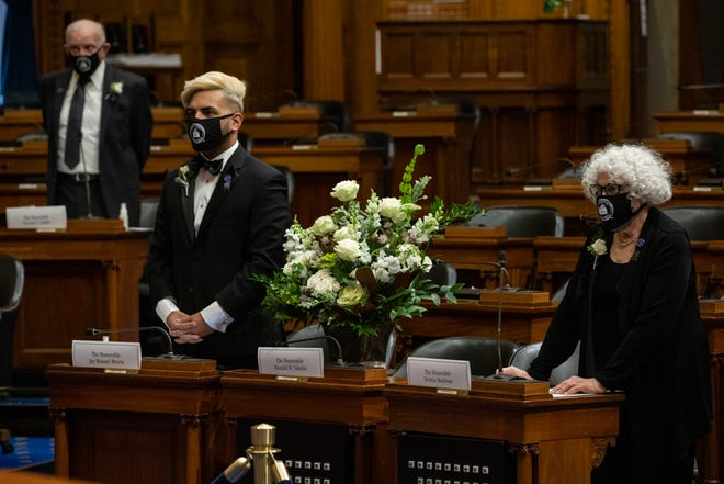A bouquet of flowers was placed at the seat assigned to Ronald Valerio, an elector who died last week.