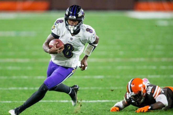 Ravens quarterback Lamar Jackson runs the ball past Browns strong safety Karl Joseph during the second quarter Monday night.