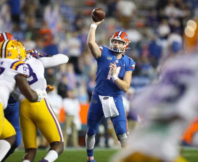 Florida quarterbacks Kyle Trask (11) accounted for four touchdowns and all three turnovers, first putting his teammates in a hole and then helping them climb out of it Saturday against LSU at Ben Hill Griffin Stadium.