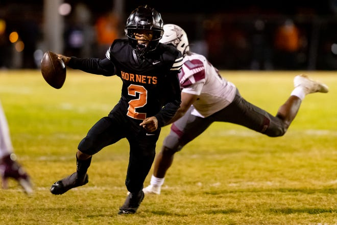 Hawthorne Hornets quarterback Chaz Mackey (2) escapes the defense on a scramble during the Hawthorne Hornets vs. Madison Cowboys football game in the semifinals of the 2020 FHSAA Football State 1A Championships at Hawthorne HS Football Fields in Hawthorne on Dec. 4.