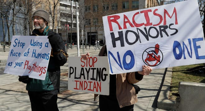 Protesters demonstrate against the Cleveland Indians before one of the team's baseball games in 2019 in Cleveland.