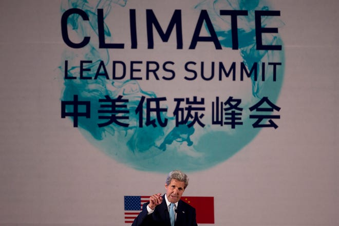 Former U.S. Secretary of State John Kerry gestures as he speaks during a climate summit in China in 2016.