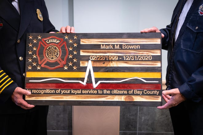 Chief Mark Bowen is presented with a plaque commemorating his time with Bay County.